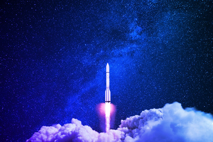 Rocket launching into the a dark sky to represent the launch of Sonatype Lift, a code quality analysis tool that takes your application development to the next level