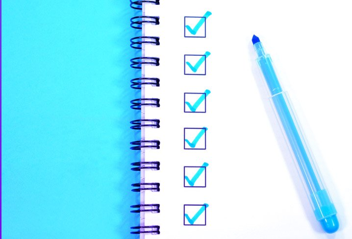 image of notebook with checkmarks representing software bill of materials