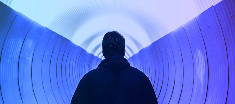 Man looking down a tunnel